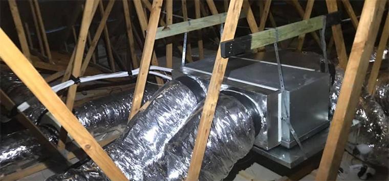 Installation climatisation gainable combles perdus